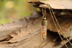 Magische Flöckchen Kette - Metallisch bunt und bronzefarben - Kleine Phiole